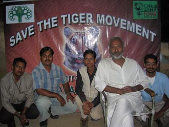 Nirvana Bodhisattva with poster for Save the Tiger Movement in background