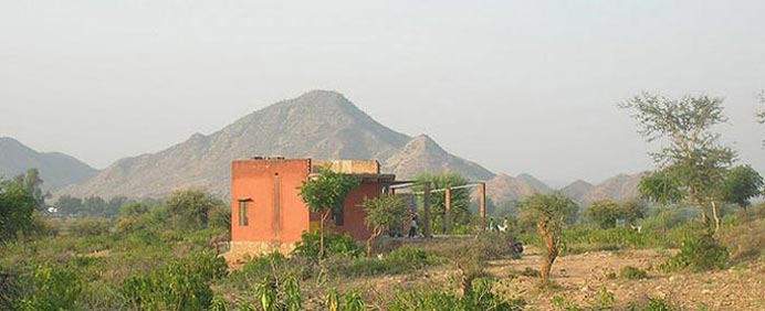 Advaita Garden school with the Aravali mountains in the background